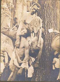 "The corpses of five African American males, Nease Gillepsie, John Gillepsie, ""Jack"" Dillingham, Henry Lee, and George Irwin with onlookers.   August 6, 1906.  Salisbury, North Carolina.  Gelatin silver print.  Real photo postcard. 3 1/2 x 5 1/2 in."